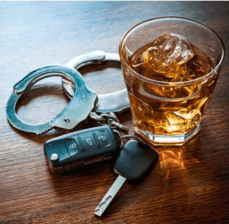 Handcuffs next to an alcoholic drink and a set of car keys